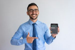 Man holding a calculator smiling