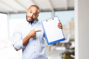 man holding a score list